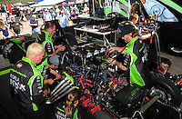 Mar. 9, 2012; Gainesville, FL, USA; Crew members work on the car of NHRA funny car driver Alexis DeJoria during qualifying for the Gatornationals at Auto Plus Raceway at Gainesville. Mandatory Credit: Mark J. Rebilas-