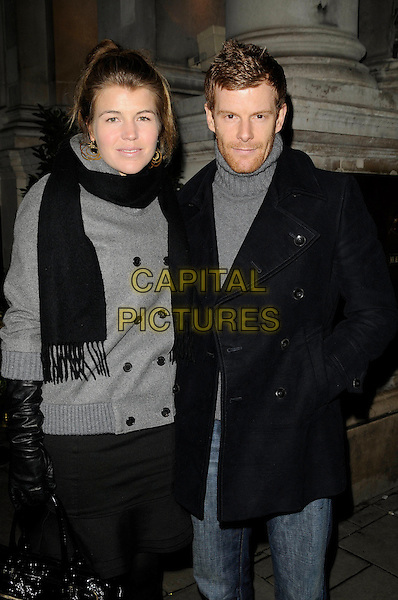 AMBER NUTTALL & TOM AIKENS.At the Tatler Restaurant Awards, Mandarin Oriental Hotel, London, England, January 19th 2009..half length black scarf married husband wife grey gray coat leather long gloves jeans jacket .CAP/CAN.©Can Nguyen/Capital Pictures