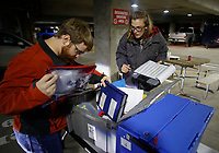 NWA Democrat-Gazette/DAVID GOTTSCHALK Laura Shepard-Johnson (right), with the Washington County Election Commission, checks off Tuesday, November 6, 2018,ballot box, tablet and election equipment as it arrives back at the Washington County Courthouse in Fayetteville. Equipment and ballots were being collected from 47 Voting Centers in the county.