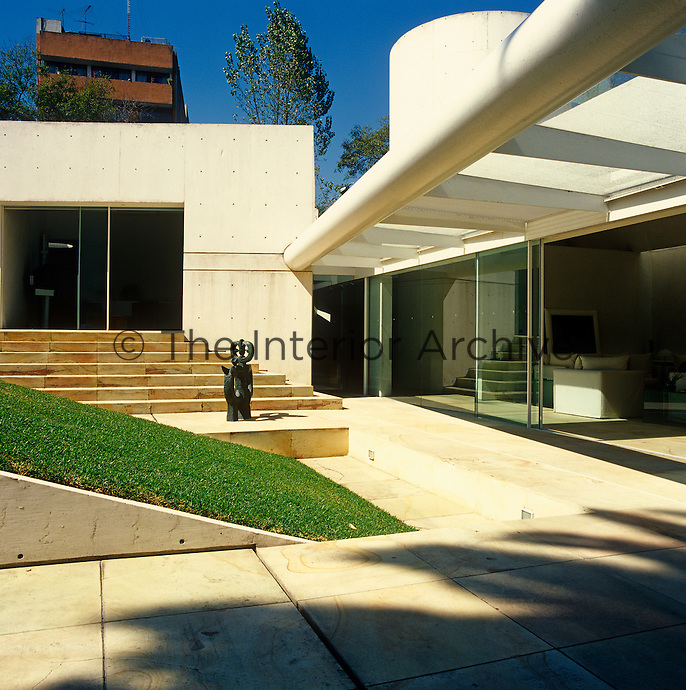 A view of the courtyard with steps leading up to the master bedroom in this contemporary Mexican home