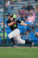 Logan Taylor (14) of the Great Falls Voyagers follows through on his swing against the Helena Brewers at Centene Stadium on August 18, 2017 in Helena, Montana.  The Voyagers defeated the Brewers 10-7.  (Brian Westerholt/Four Seam Images)