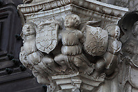 Sculptural detail of cherubs holding coats of arms, on the South Portal, 1516-18, by Joao de Castilho, 1470ñ1552, after a design by Diogo de Boitaca, Church of Santa Maria, at the Jeronimos Monastery or Hieronymites Monastery, a monastery of the Order of St Jerome, built in the 16th century in Late Gothic Manueline style, Belem, Lisbon, Portugal. The portal consists of double doors with a tympanum carved with scenes from the life of St Jerome, a statue of Henry the Navigator, many carved statues in niches, a statue of the Madonna and many flamboyant pinnacles and gables in Manueline style. The monastery is listed as a UNESCO World Heritage Site. Picture by Manuel Cohen