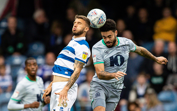 Blackburn Rovers' Derrick Williams competing with Queens Park Rangers' Jan Mlakar (left)  <br /> <br /> Photographer Andrew Kearns/CameraSport<br /> <br /> The EFL Sky Bet Championship - Queens Park Rangers v Blackburn Rovers - Saturday 5th October 2019 - Loftus Road - London<br /> <br /> World Copyright © 2019 CameraSport. All rights reserved. 43 Linden Ave. Countesthorpe. Leicester. England. LE8 5PG - Tel: +44 (0) 116 277 4147 - admin@camerasport.com - www.camerasport.com