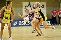 Katrina Grant ( Pulse ) and Caitlyn Nevins ( Firebirds ) in action during the ANZ Championship - Mojo Pulse v Queensland Firebirds at Te Rauparaha Arena, Porirua, New Zealand on Sunday 8 March 2015. <br /> Photo by Masanori Udagawa. <br /> www.photowellington.photoshelter.com.