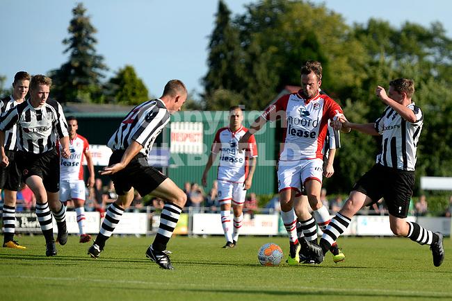SCHOONEBEEK - Voetbal, SVV 04 - FC Emmen, voorbereiding seizoen 2018-2019, 06-07-2018,  FC Emmen speler Anco Jansen probeert door de SVV defensie te komen