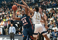 WASHINGTON, DC - NOVEMBER 16: Mezie Offurum #15 of George Washington defends against Mohamed Camara #14 of Morgan State during a game between Morgan State University and George Washington University at The Smith Center on November 16, 2019 in Washington, DC.