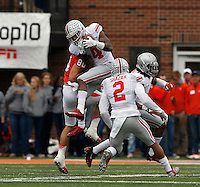 Ohio State Buckeyes safety C.J. Barnett (4) intercepts a pass intended for Illinois Fighting Illini wide receiver Spencer Harris (80) during the NCAA football game at Illinois on Saturday, November 16, 2013. (Columbus Dispatch photo by Barbara J. Perenic)