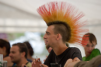 A participant enjoys his time on Sziget festival held in Budapest, Hungary on August 07, 2011. ATTILA VOLGYI
