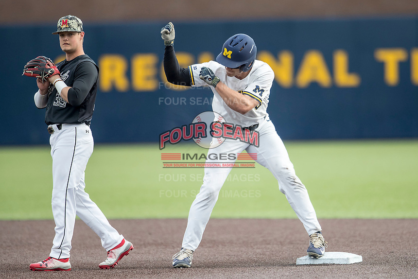 Michigan Wolverines outfielder Jonathan Engelmann (2) celebrates after hitting a double against the Maryland Terrapins on April 13, 2018 in a Big Ten NCAA baseball game at Ray Fisher Stadium in Ann Arbor, Michigan. Michigan defeated Maryland 10-4. (Andrew Woolley/Four Seam Images)