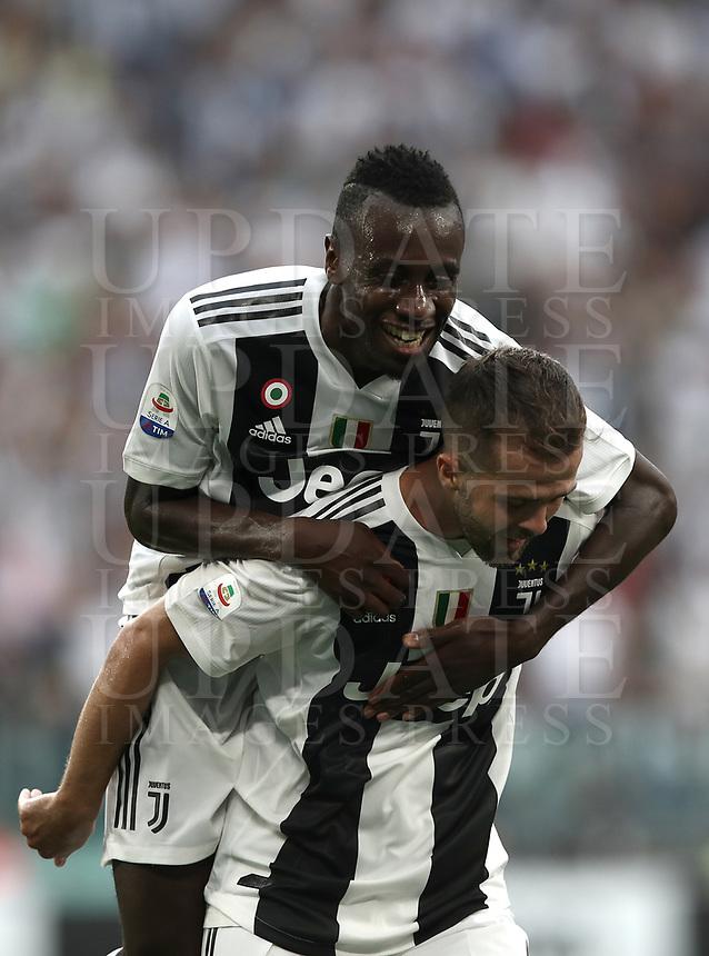 Calcio, Serie A: Juventus - Lazio, Torino, Allianz Stadium, 25 agosto, 2018.<br /> Juventus' Miralem Pjanic (bottom) celebrates after scoring with his teammate Blaise Matuidi (i) during the Italian Serie A football match between Juventus and Lazio at Torino's Allianz stadium, August 25, 2018.<br /> UPDATE IMAGES PRESS/Isabella Bonotto