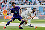 Real Madrid's Francisco Alarcon 'Isco' and Real Club Celta de Vigo's Okay Yokuslu during La Liga match between Real Madrid and Real Club Celta de Vigo at Santiago Bernabeu Stadium in Madrid, Spain. March 16, 2019. (ALTERPHOTOS/A. Perez Meca)
