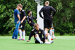 Stockholm 2014-06-07 Fotboll Superettan Hammarby IF - Tr&auml;ning :  <br /> Erik Israelsson tar av sig skorna under Hammarbys tr&auml;ning p&aring; &Aring;rsta IP den 7 juni 2014<br /> (Foto: Kenta J&ouml;nsson) Nyckelord:  Superettan  HIF Bajen Tr&auml;ning &Aring;rsta IP depp besviken besvikelse sorg ledsen deppig nedst&auml;md uppgiven sad disappointment disappointed dejected