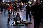 Handicapped man begs in a comercial street in Madrid during a winter cold wave. 08/02/2012