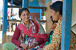 Gita Dhital (left), a psycho-social volunteer for the ACT Alliance, talks with Binita Pariyar and her 9-year old son Kabin in Makaising, a village in the Gorkha District of Nepal that was hard hit by the country's 2015 earthquake. Dan Church Aid, a member of the ACT Alliance, has provided a variety of support to local villagers, including emotional support for families like this one struggling with the emotional aftermath of the quake.