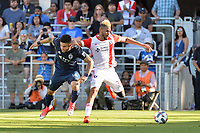 San Jose, CA - Saturday June 17, 2017: Dom Dwyer, Anibal Godoy during a Major League Soccer (MLS) match between the San Jose Earthquakes and the Sporting Kansas City at Avaya Stadium.