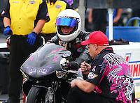 May 15, 2015; Commerce, GA, USA; A crew member with NHRA pro stock motorcycle rider Chip Ellis during qualifying for the Southern Nationals at Atlanta Dragway. Mandatory Credit: Mark J. Rebilas-USA TODAY Sports