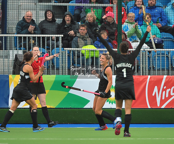 Captain Kayla Whitelock (NZL) raises her arms to celebrate the goal scored by Gemma Flynn (NZL, centre). South Africa (RSA) v New Zealand (NZL). Womens bronze medal match. Hockey. PHOTO: Mandatory by-line: Garry Bowden/SIPPA/Pinnacle - Tel: +44(0)1363 881025 - Mobile:0797 1270 681 - VAT Reg No: 183700120 - 020814 - Glasgow 2014 Commonwealth Games - Glasgow national hockey centre, Glasgow, Scotland, UK