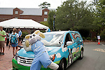 August 20, 2011. Chapel Hill, NC.. At a move in day event, the UNC mascot poses in front of a Ben & Jerry's van which brought free ice cream to students and parents.. Many companies have increased their efforts to reach the youth market by employing popular college students to raise the awareness of the brand by peer to peer marketing on campus' around the country.