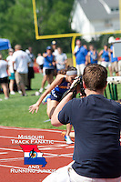 With just her lower leg and hair visible, Rockwood Summit freshman Melissa Menghini lies on track while Seckman senior Katelyn Evans stumbles just before the finish line of the Missouri Class 4 Sectional 1 Girls 800 meters at MICDS in St. Louis, Saturday, May 18, 2013.