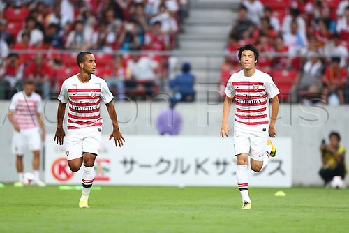 22.07.2013. Nagoya, Japan.  (L-R)  Theo Walcott and Ryo Miyaichi of Arsenal warm up before the Pre-season friendly match between Nagoya Grampus 1-3 Arsenal at Toyota Stadium in Nagoya, Japan.