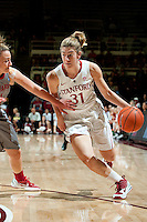 STANFORD, CA-JANUARY 18, 2012 - Toni Kokenis drives against a defender in the first half against the Washington State Cougars.