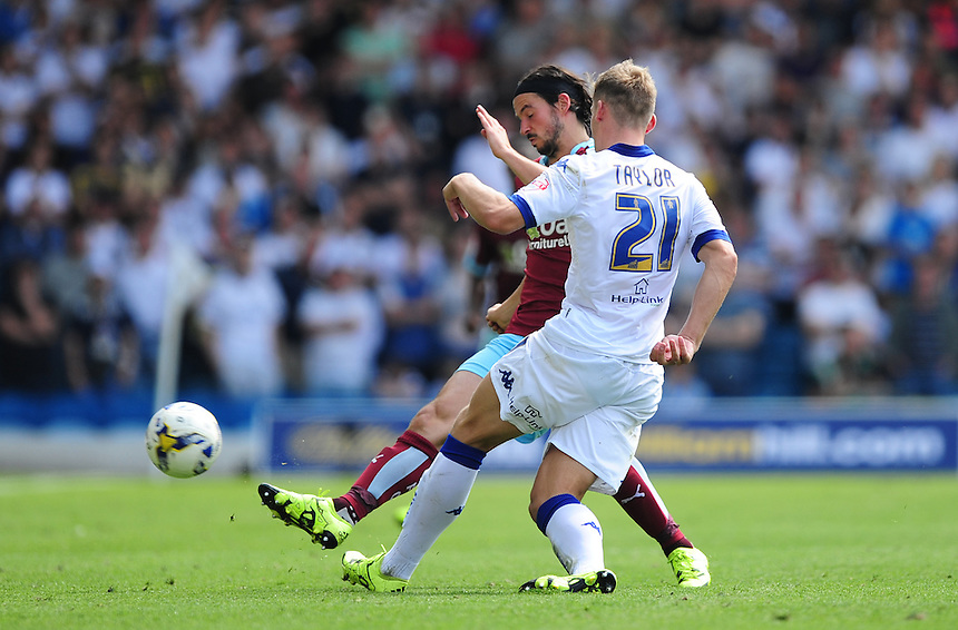 Leeds United's Charlie Taylor under pressure from Burnley's George Boyd<br /> <br /> Photographer Chris Vaughan/CameraSport<br /> <br /> Football - The Football League Sky Bet Championship - Leeds United  v Burnley - Saturday 8th August 2015 - Elland Road - Beeston - Leeds<br /> <br /> &copy; CameraSport - 43 Linden Ave. Countesthorpe. Leicester. England. LE8 5PG - Tel: +44 (0) 116 277 4147 - admin@camerasport.com - www.camerasport.com