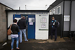Clitheroe 0 Consett 1, 20/08/2016. Shawbridge, Northern Premier League Division One North. Two spectators and a home player arrive at the ground before Clitheroe played Consett at Shawbridge in an FA Cup preliminary round tie. Northern Premier League division one north team Clitheroe were formed in 1877 and have played at the same ground since 1925. Visitors Consett, from the Northern League division one, won the match 1-0, watched by 207 spectators. Photo by Colin McPherson.