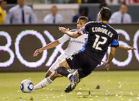 LA Galaxy defender Sean Franklin (28) beats San Jose Earthquake defender Ramiro Corrales (12) to the ball. The LA Galaxy and the San Jose Earthquakes played to a 2-2 draw at Home Depot Center stadium in Carson, California on Thursday July 22, 2010.