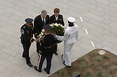Arlington, VA - September 11, 2008 -- Retired United States Air Force General Richard B. Myers, former chairman of the Joint Chiefs of Staff; American Airlines flight attendant Deborah Maitland-Rowland; and Lieutanant David Webster, a Pentagon Force Protection Agency officer, place a wreath at the Pentagon Memorial Sept. 11, 2008, during its dedication ceremony. The memorial consists of 184 inscribed memorial units honoring the 59 people aboard American Airlines Flight 77 and the 125 in the Pentagon who lost their lives Sept. 11, 2001..Credit: Jennifer Villalovos - DoD via CNP