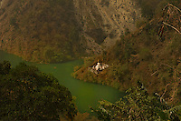 A bird'e eye view of a monastery by the river in a valley of the Himalayan foothills, Sikkim, India