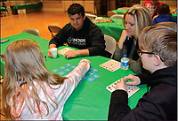 File photo<br /> <br /> Attendees of last year's family game night each took their turns in a Dr. Suess Matching game. Pictured, (from left) is father Henry Janes, mother Becky Janes, Truman Janes, 13, and Hailey Janes, 9.