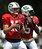 New York Jets quarterbacks Josh McCown #15, left, and Teddy Bridgewater #5 throw passes during team practice at the Atlantic Health Jets Training Center in Florham Park, NJ on Sunday, July 29, 2018.
