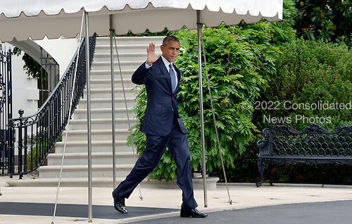 United States President Barack Obama waves to the press as he walks to Marine One on the South Lawn of the White House June 16, 2016 in Washington, DC. Obama will travel to Orlando, Florida on Thursday to pay respects to the victims of Sunday's nightclub shooting and to stand in solidarity with the community.<br /> Credit: Olivier Douliery / Pool via CNP