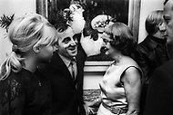 October 1966. Manhattan, NYC. Bette Davis congratulates Charles Aznavour after his performace at the Garry Moore Show at the CBS Studio 50. Ulla Thorsell on the left.