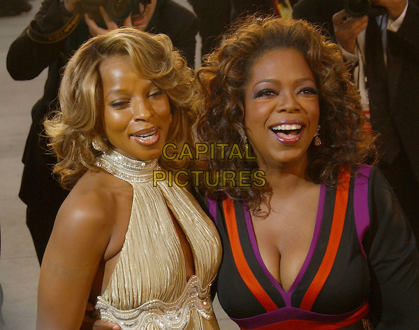 MARY J. BLIGE & OPRAH WINFREY.The 2007 Vanity Fair Oscar Party Hosted by Graydon Carter held at Morton's, West Hollywood, California, USA,.25 February 2007..half length hugging funny laughing gold black patterned dress.CAP/ADM/GB.©Gary Boas/AdMedia/Capital Pictures.