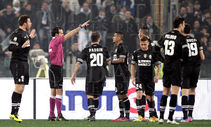 Calcio, semifinale di ritorno di Coppa Italia: Lazio vs Juventus. Roma, stadio Olimpico, 29 gennaio 2013..Juventus players appeal to referee Luca Banti during the Italy Cup football semifinal return leg match between Lazio and Juventus at Rome's Olympic stadium, 29 January 2013..UPDATE IMAGES PRESS/Riccardo De Luca