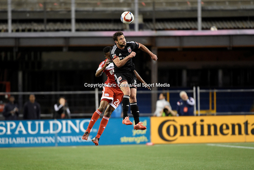 May 23, 2015 - Foxborough, Massachusetts, U.S. - D.C. United midfielder Chris Pontius (13) heads the ball during the MLS game between DC United and the New England Revolution held at Gillette Stadium in Foxborough Massachusetts. The New England Revolution and D.C. United ended the game tied 1-1.  Eric Canha/CSM