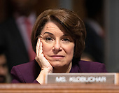 United States Senator Amy Klobuchar (Democrat of Minnesota) listens as the US Senate Committee on the Judiciary holds a vote on the nomination of Judge Brett Kavanaugh to be Associate Justice of the US Supreme Court to replace the retiring Justice Anthony Kennedy on Capitol Hill in Washington, DC on Friday, September 28, 2018.  If the committee votes in favor of Judge Kavanaugh then it goes to the full US Senate for a final vote.<br /> Credit: Ron Sachs / CNP<br /> (RESTRICTION: NO New York or New Jersey Newspapers or newspapers within a 75 mile radius of New York City)