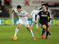(L-R) Jack Cork of Swansea against Jose Manuel Jurado of Watford during the Barclays Premier League match between Swansea City and Watford at the Liberty Stadium, Swansea on January 18 2016