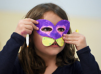 NWA Democrat-Gazette/CHARLIE KAIJO Abigail Hinojosa, 7, of Bentonville puts on a mask for a superhero she created called &quot;Butterfly&quot; Girl during a weeklong camp about superheroes, Thursday, March 21, 2019 at the Amazeum in Bentonville. <br /> <br /> Campers honed their superhero knowledge to create their own action figures and Comi-Con displays in a weeklong superhero camp that concludes Friday. They started the camp with a visit to Crystal Bridges to see the new exhibit, &ldquo;Men of Steel, Women of Wonder&rdquo; before making their own