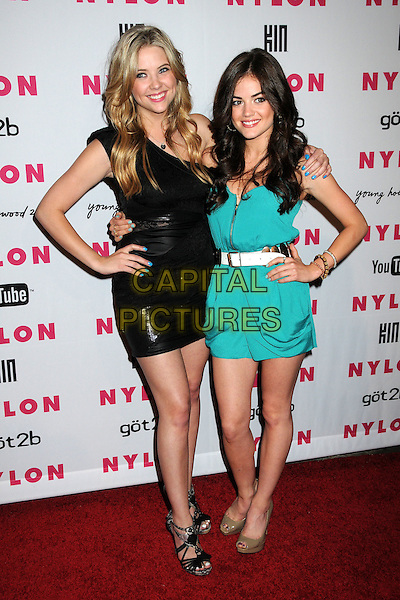 ASHLEY BENSON & LUCY HALE.Nylon Magazine's Young Hollywood Party held at the Roosevelt Hotel's Tropicana Bar, Hollywood, California, USA..May 12th, 2010.full length black one shoulder dress hands on hips blue nail varnish polish green turquoise white arm over shoulder .CAP/ADM/BP.©Byron Purvis/AdMedia/Capital Pictures.