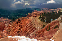 732700001 a clearing summer storm over sunset vista still partially covered in snow highlights the red rock country and vast forests the area is noted forr in cedar breaks national monument utah