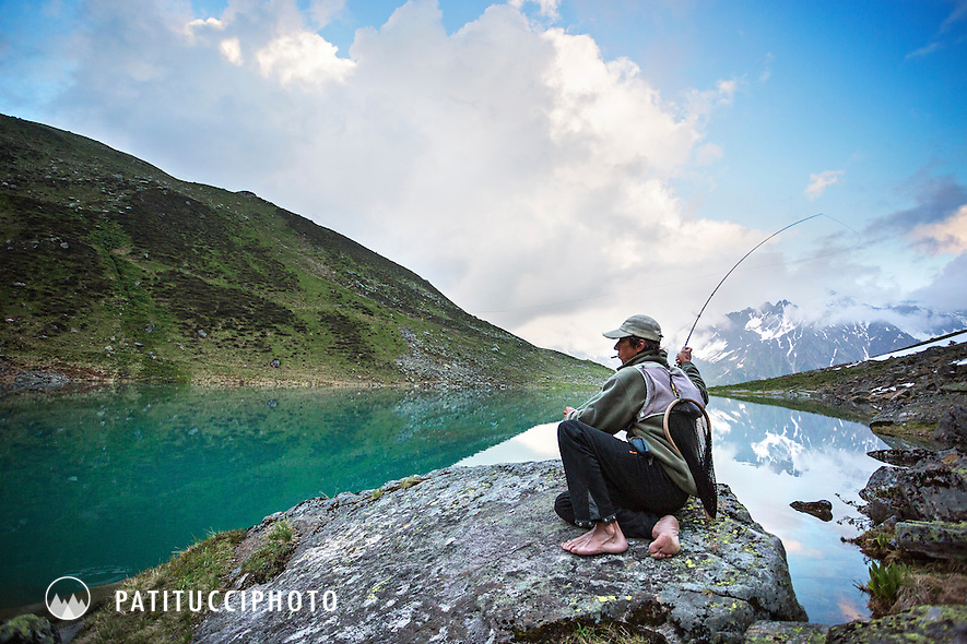 Fly fisherman Beat Schlegel, a fishing guide, located in Eastern Switzerland, was photographed as a story because he's one of the few fly fishing experts in Switzerland and a character who does not ever wear shoes and is passionate about fishing.