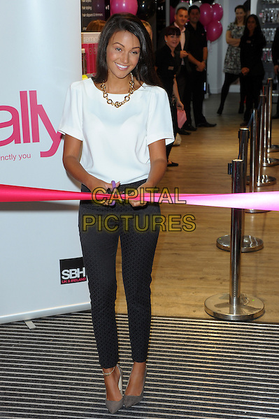 Michelle Keegan<br /> Opens the new Sally Salon in New Oxford street, London, England.<br /> September 12th, 2013<br /> full length white t-shirt black grey gray trousers scissors cutting ribbon<br /> CAP/CJ<br /> &copy;Chris Joseph/Capital Pictures