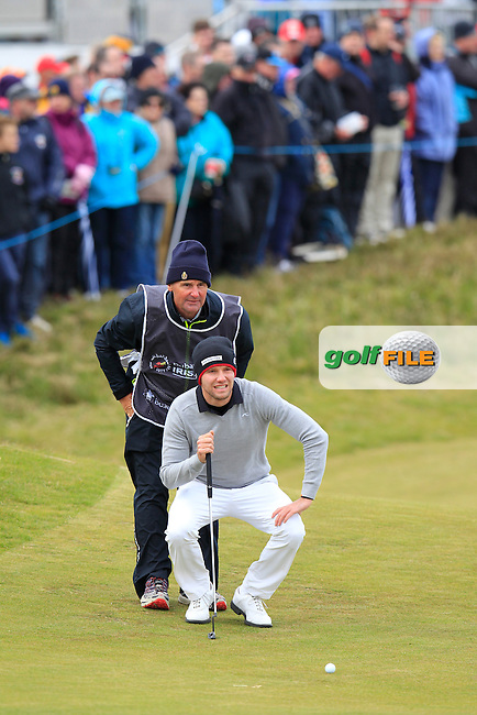 Maximilian KIEFFER (GER) lines up his putt onto the 18th green during Saturday's Round 3 of the 2015 Dubai Duty Free Irish Open, Royal County Down Golf Club, Newcastle Co Down, Northern Ireland 5/30/2015<br /> Picture Eoin Clarke, www.golffile.ie