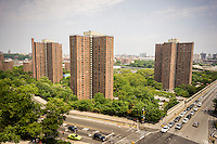 The massive NYCHA Polo Grounds Houses complex of apartments in Harlem in New York is seen on Sunday, July 13, 2014. New York Mayor De Blasio has announced numerous ties that his administration will be creating affordable housing.  (© Richard B. Levine)