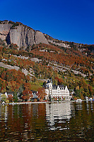 Hotel in autumn, along shore of Lake Lucerne from sightseeing boat, Lake Lucerne, Switzerland.