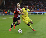 Harry Chapman of Sheffield United tussles with Byron Moore of Bristol Rovers  during the EFL League One match at the Bramall Lane Stadium, Sheffield. Picture date: September 27th, 2016. Pic Jamie Tyerman/Sportimage