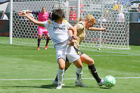 Aya Miyama #8 of the Los Angeles Sol battles for control of the ball against FC Gold Pride during their match at Home Depot Center on April 19, 2009 in Carson, California.