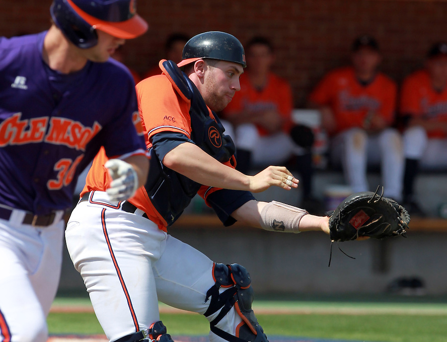 Virginia catcher Nate Irving (18) catches a pop up from Clemson catcher Garrett Boulware (30) during the game Sunday at Davenport Field in Charlottesville, VA. Photo/Daily Progress/Andrew Shurtleff